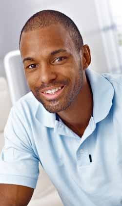 smiling man in autism treatment program
